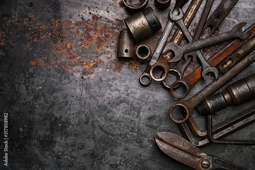 Obraz Flat lay Old hand tools ,Pliers screwdriver wrench rusted iron metal tools on Steel plate at garage - fototapety do salonu