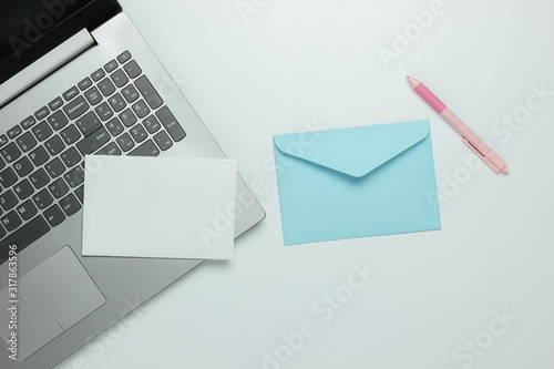 Laptop and envelope with letter on white background Wallpaper Mural