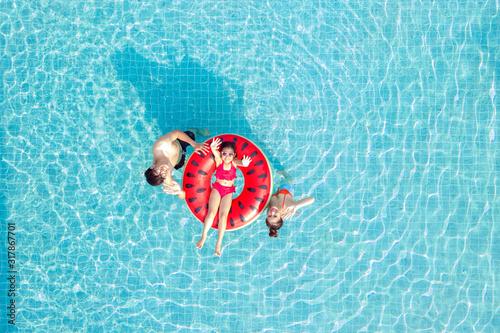 Fototapeta Asian family relax in swimming pool obraz