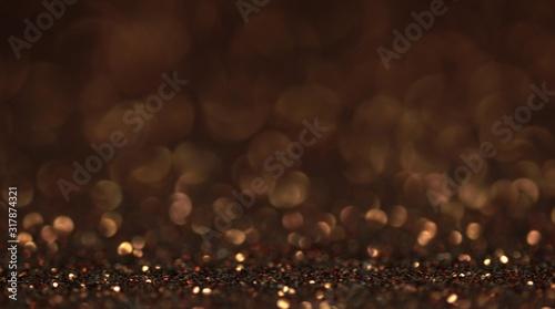 Obraz Brown bokeh holiday background. Magic shiny texture - fototapety do salonu