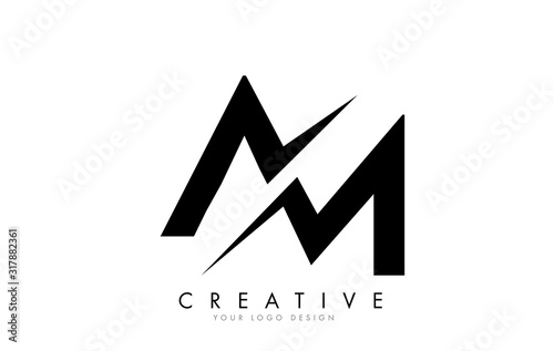 Fotografie, Obraz AM A M Letter Logo Design with a Creative Cut.