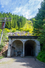 A Bicycle At The Entrance Of The Snoqualmie Tunnel On The Iron Horse Trail In The Snoqualmie Forest, Washington, USA