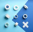 Leinwanddruck Bild - Different types of sticking plasters on blue background, flat lay