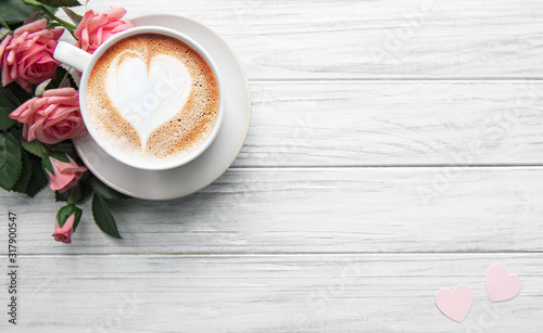 Obraz A cup of coffee with heart pattern - fototapety do salonu