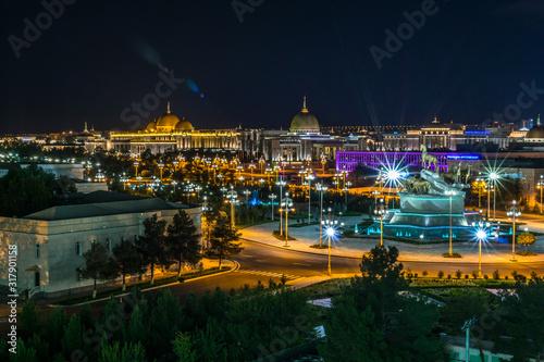 Night view of the presidential palace (Oguzhan) in Ashgabat Turkmenistan Wallpaper Mural