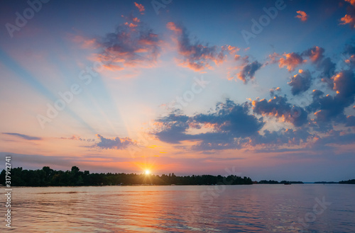 Wall mural - Fantastic colorful sunset with cloudy sky.