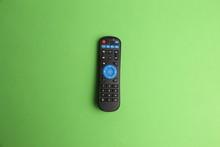 TV Remote Control In Color Bac...