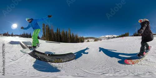 SELFIE: Snowboarder takes a selfie of her boyfriend doing a jib along a railing Fototapeta