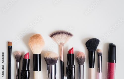 Fototapeta Make up concept: Professional makeup tools and accessories. Lipstick, mascara, nail polish, eyeshadow, powder, eyelash and foundation. Top view. obraz