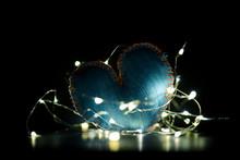 HEART SHAPE OVER BLACK BACKGROUND