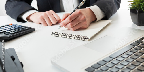 Close up view of bookkeeper or financial inspector hands making report, calculating or checking balance Canvas Print