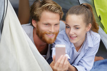Couple Taking Selfie In Campin...