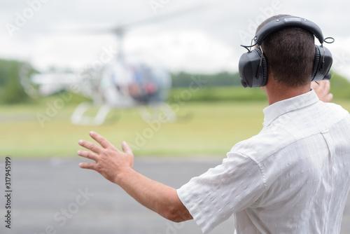 Obraz na plátne a man controls a helicopter