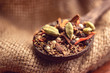 mix spices and herbs in a wooden spoon on dark background, Indian spices food and cuisine ingredients