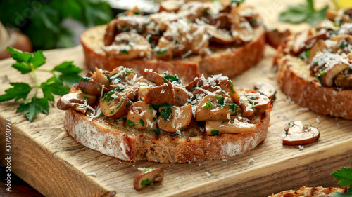 Grilled mushroom toast with parsley, lemon and parmesan cheese on wooden board Wallpaper Mural