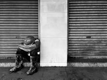 WORKER SLEEPING ON STREET