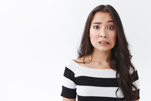 Embarrassed And Confused Insecure Young Asian Female Made Mistake, Feel Sorry Or Pity, Cringe Nervously, Clench Teeth And Pulling Sad Worried Face, Frowning Panicking, Standing White Background