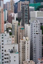 Very Dense Part Of Hong Kong, View From A High Point Of The Several Buildings Facade