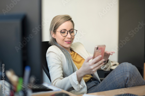 Obraz Beauty woman working happy at office, phone distraction - fototapety do salonu