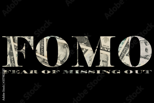 Photo The word fomo written from banknotes US dollar in the black background, selectiv