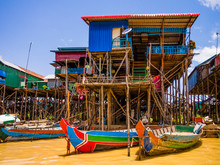 Traditional Kampong Phluk Floating Village With Multicolored Boats And Stilt Houses, Tonle Sap Lake, Siem Reap Province, Cambodia