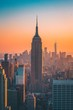 Empire State Building In Cityscape At Sunset