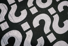 High Angle View Of Question Mark Sign On Road