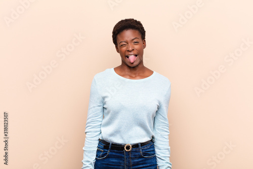 young pretty black womanlooking goofy and funny with a silly cross-eyed expressi Canvas Print