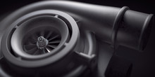 Car Turbocharger On Black Background. Auto Part Turbo Engine Technology Concept.