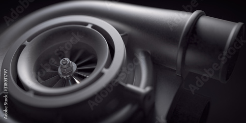 Fototapeta Car turbocharger on black background. Auto part turbo engine technology concept. obraz