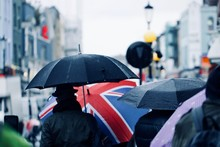 People With Umbrella Walking I...