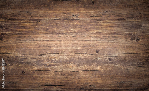 Wood texture background. Top view of vintage wooden table with cracks. Brown rustic rough timber for backdrop.