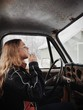 Side View Of Young Woman Driving Car