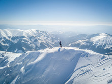 Man Standing On Snowcapped Mou...