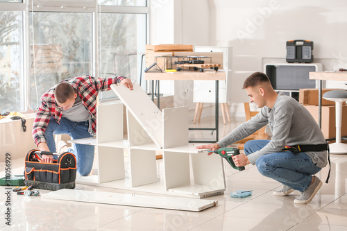 Handymen assembling furniture in workshop Wallpaper Mural