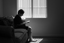 Silhouette Mature Woman Readin...