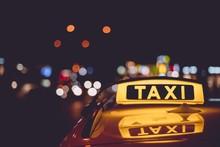 Closeup Of A Taxi Sign On A Ca...