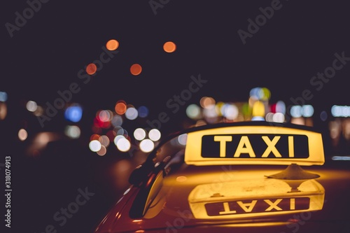 Fotografering Closeup of a taxi sign on a cab during night time