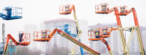 Access platform equipment powered high in sky in blue orange and yellow for high Wallpaper Mural