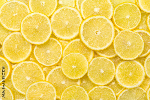 Tela Fresh lemon slices pattern backgrond, close up