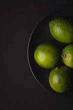 Lime Sour Fruits In Black Plat...