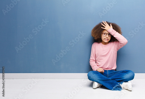 african american little girl raising palm to forehead thinking oops, after makin Fototapeta