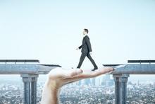 Businessman Walking Over Gap I...