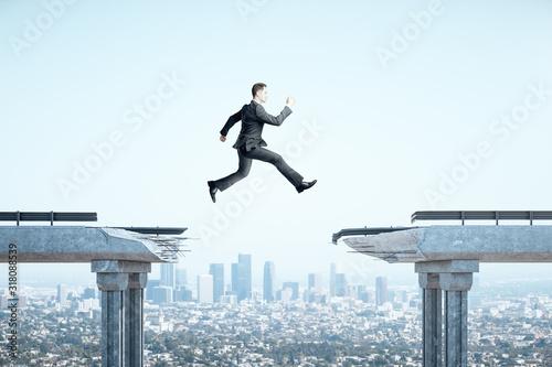 Businessman jumping over gap in bridge Canvas Print