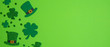 canvas print picture - Happy St. Patrick's Day banner design. Top view shamrock leaf clovers and Irish elf hats on green background. Saint Patricks Day flat lay composition