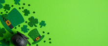 St Patrick's Day Banner Design. Irish Elf Hats, Pot Of Gold And Shamrock Leaf Clovers On Green Background With Copy Space. Happy Saint Patricks Day Concept