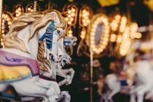 Close-Up Of Carousel Horse Sculptures At Illuminated Amusement Park