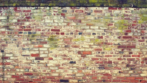 Weather worn aged brick wall