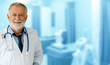 canvas print picture - Senior male doctor working at the hospital. Medical healthcare and doctor staff service.