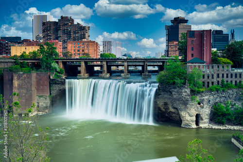 Obraz na plátne High Falls district in Rochester New York under cloudy summer skies